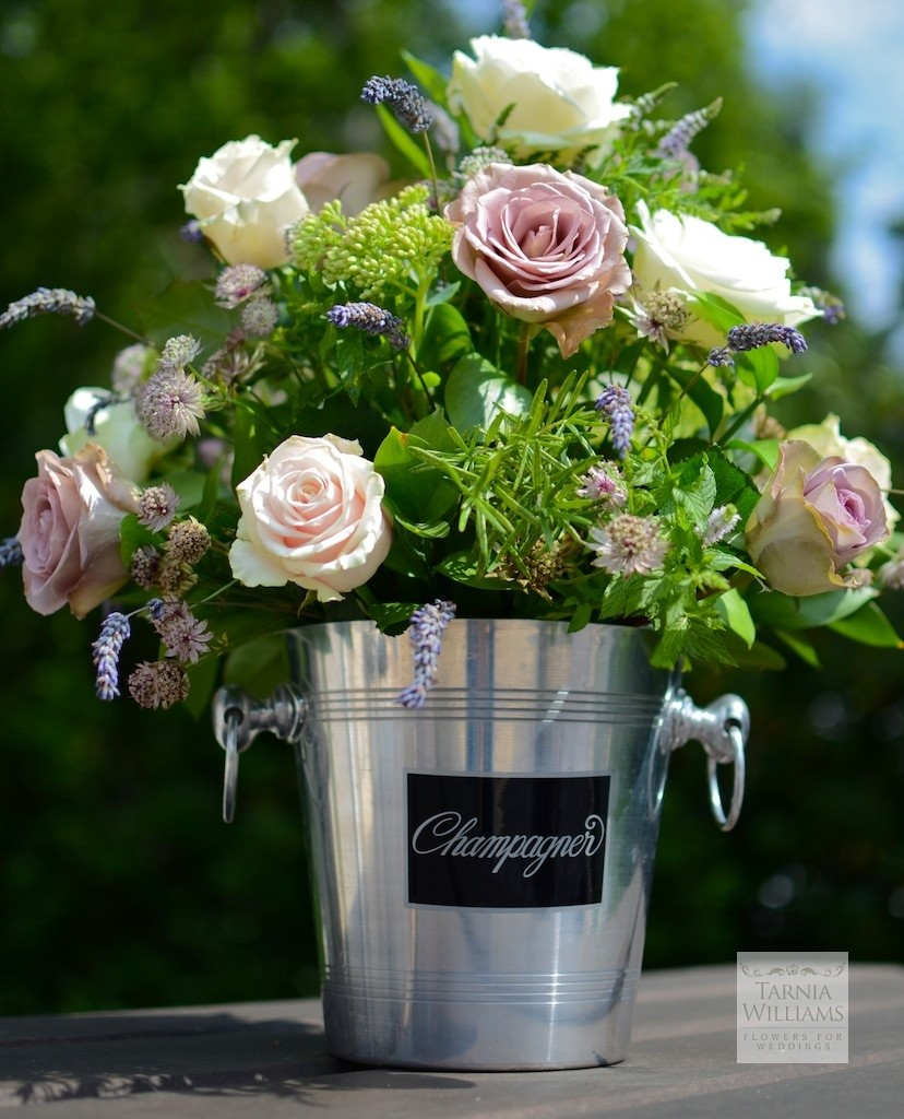 Champagne bucket table centre How to choose your wedding florist!